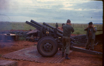 US 105mm field howitzer with barrel at  full recoil after firing     [Young]