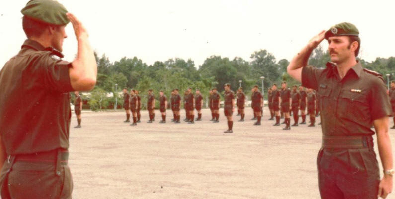 webmaster [right] as parade adjutant handing parade over to CO [his former company commander in 1970] - Dieppe Barracks Singapore late 1976 or early 1977 [Young]