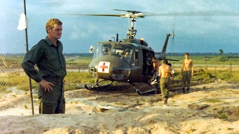 15 September - Cpl Wally Goodman with CASEVAC chopper behind, others carrying injured Vietnamese kids to chopper [Jane]